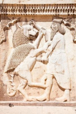Depositphotos_9195677-stock-photo-persian-soldier-bas-relief-killing